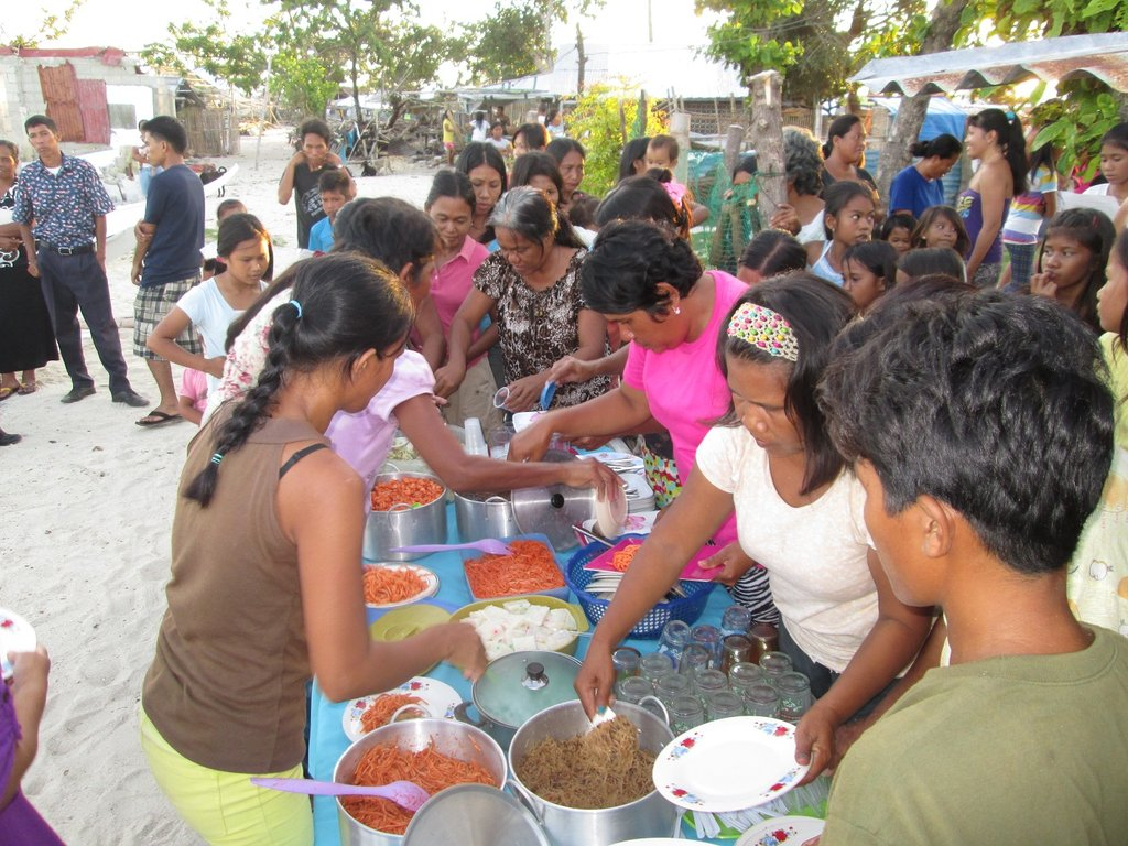 community fiesta meal celebrate new AAI  boats