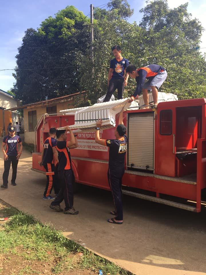 Fire fighters in Jolo help to rebuild schools