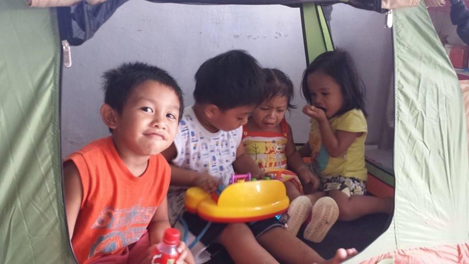 "Children in ""hobbit tents"" at Bulak, Elmentary,"