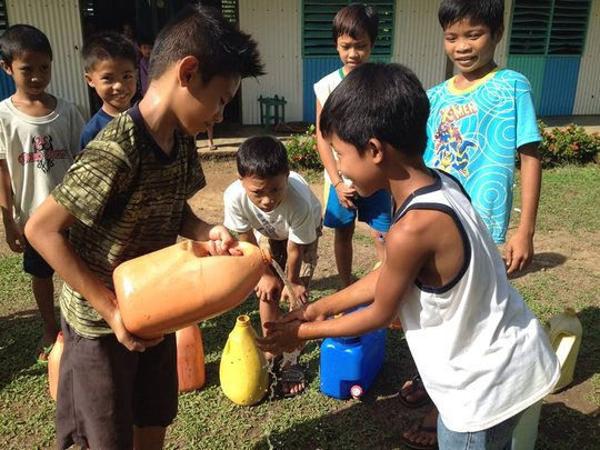Children share clean water for hygiene in school
