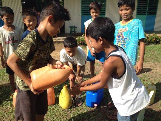 Children share clean water for hygiene in school