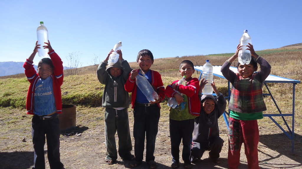 Pupils with bottles of safe drinking water