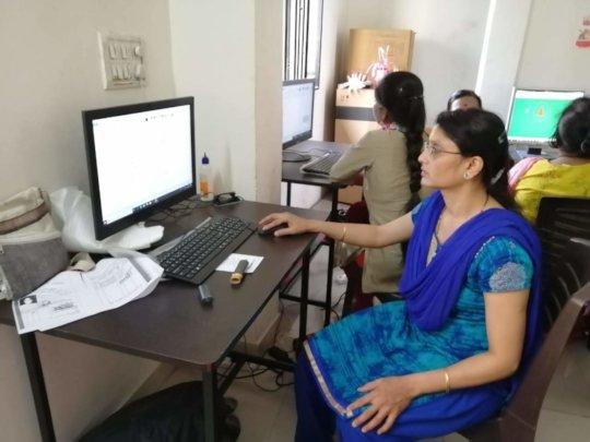Asavari taking the computer exam with confidence