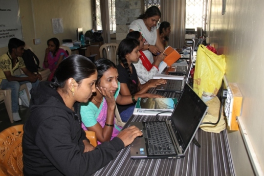 Women learning computers with enthusiasm