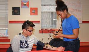 Bontu measures blood pressure during a THP event.