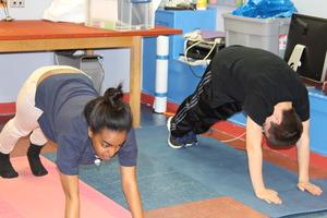 Rahel and Jordy leading yoga.