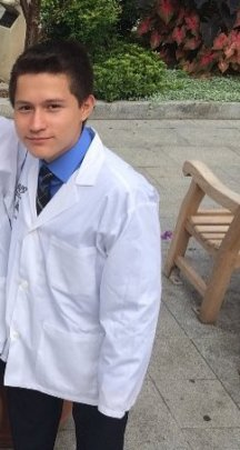 Jordy in his lab coat during an internship.