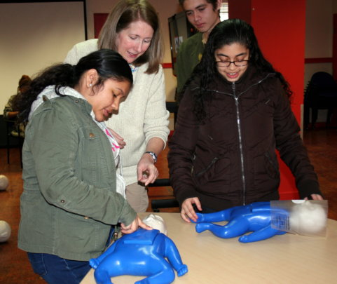 Kenia and her peers learning CPR.