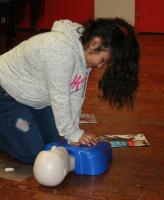 Learning CPR steps.