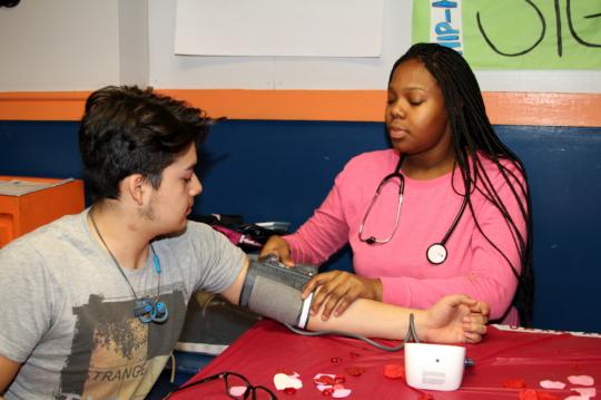 Alexis practicing vital signs measurement for GW.