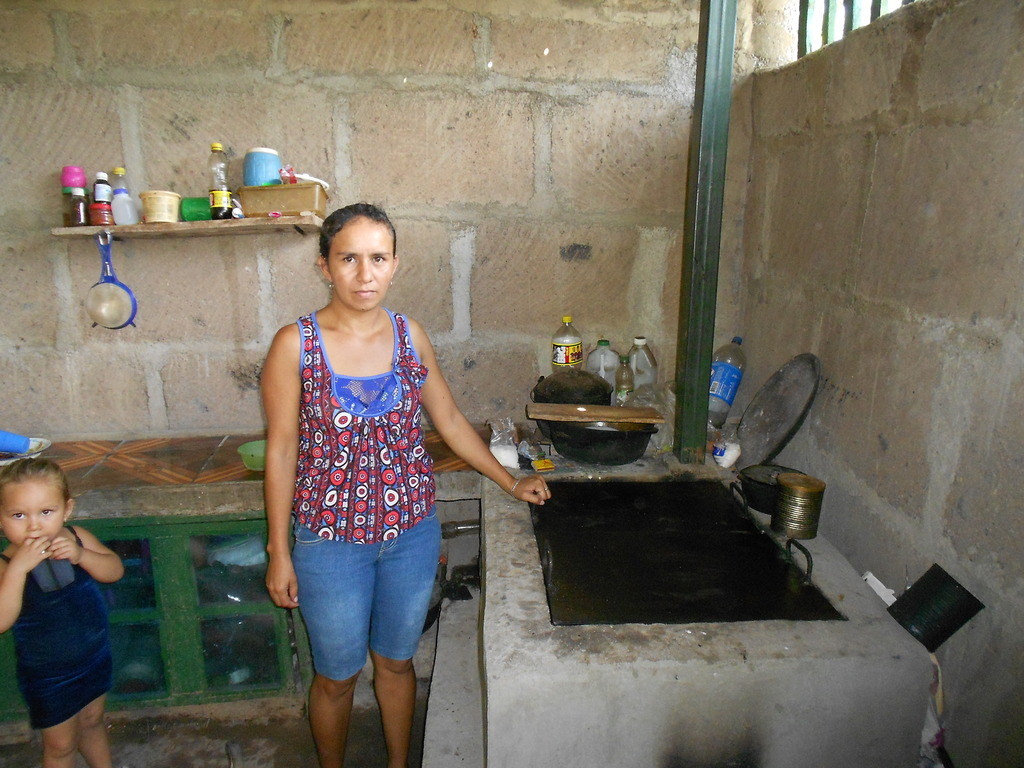 Yakeni G. and her new improved cookstove!