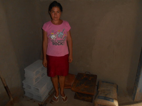 Receiving materials for her new improved cookstove