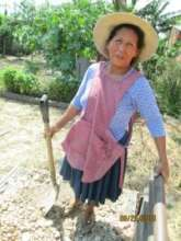 Ancelma shoveling gravel for her bathroom