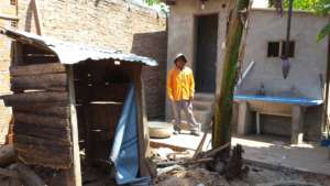 Almost done! Old pit latrine is in the foreground.