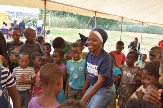 HOPE Centre Staff member with children on WDD