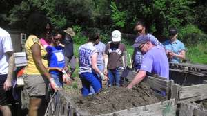 Volunteers learning about composting
