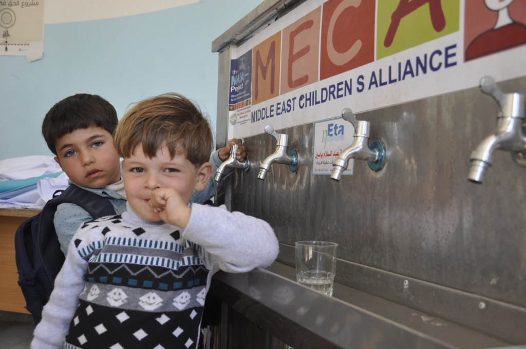 Preschool boys drink clean water