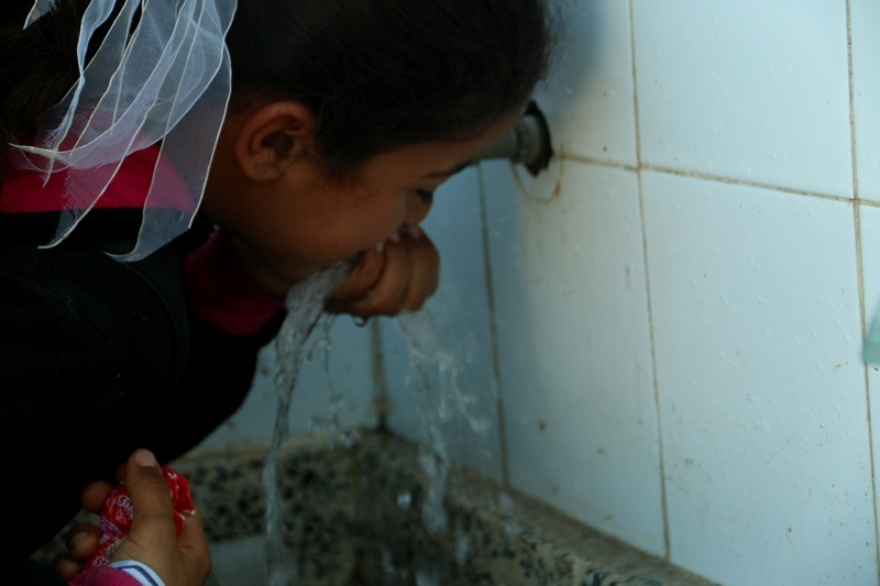 Student near Rafah drinks clean water