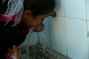 Student near Rafah drinks clean water