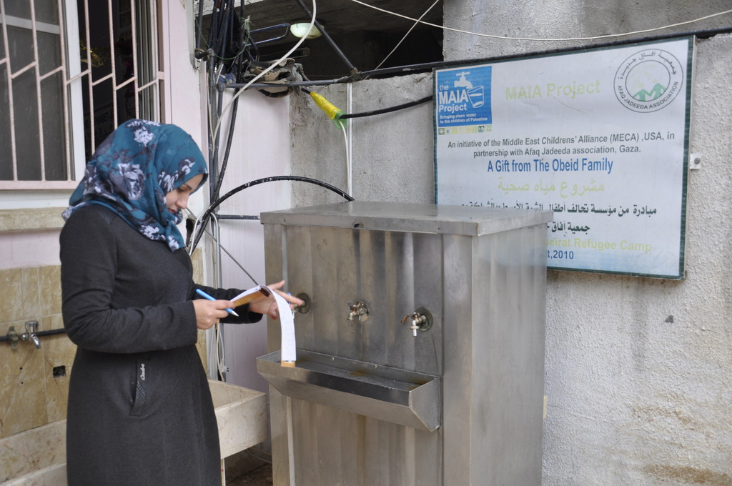Safaa tests water at school in Nuseirat, Gaza