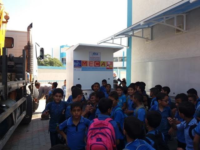 Children gather around the upgraded unit