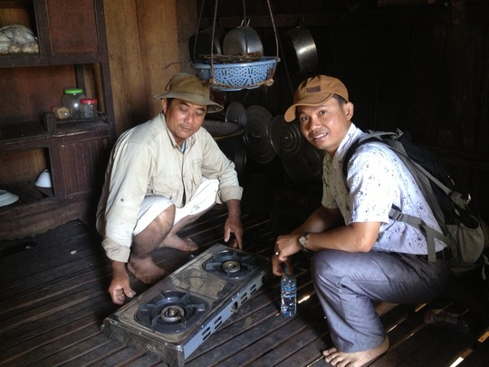 Mr. Sokheng showing his new stove he will install