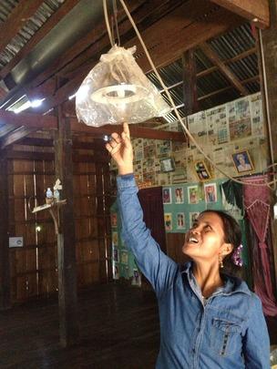 Ms. Rom showing her broken lamp