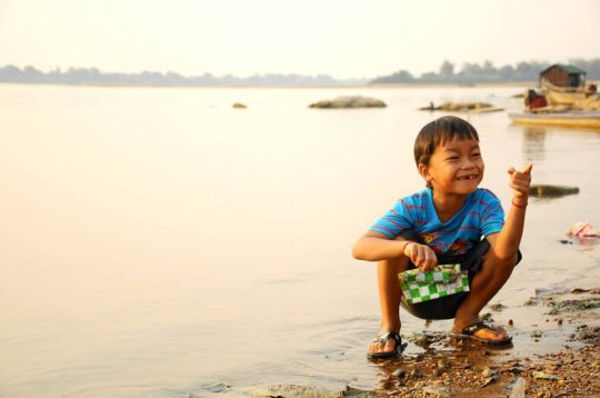 Child playing in the Mekong River