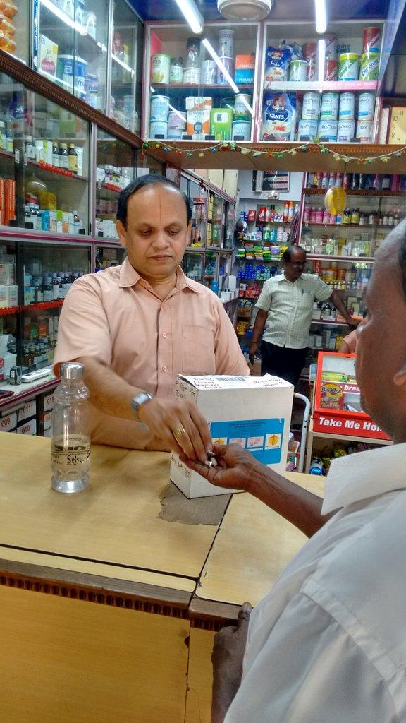Pharmacist providing DOTS to Kumar
