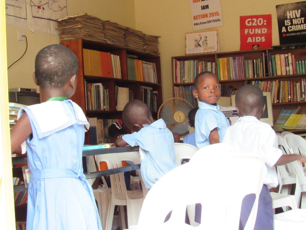 children reading inside CFYDDI resource center