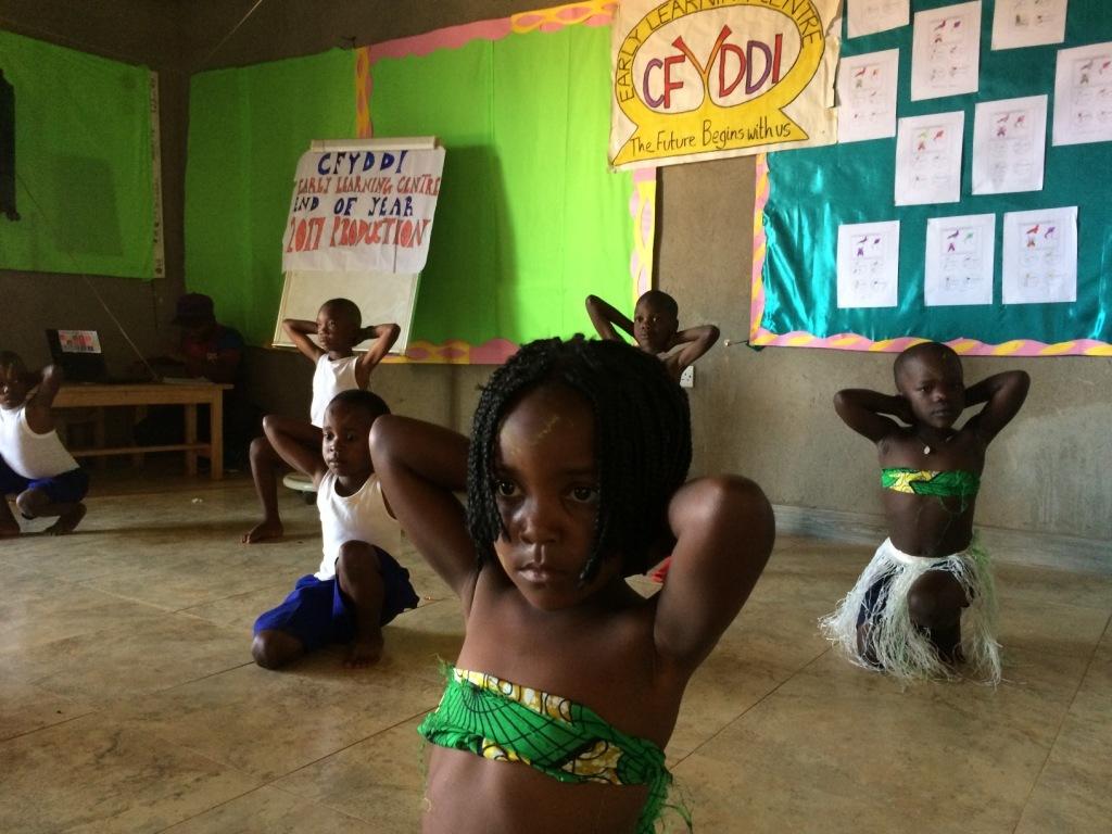 Children prepare for a performance