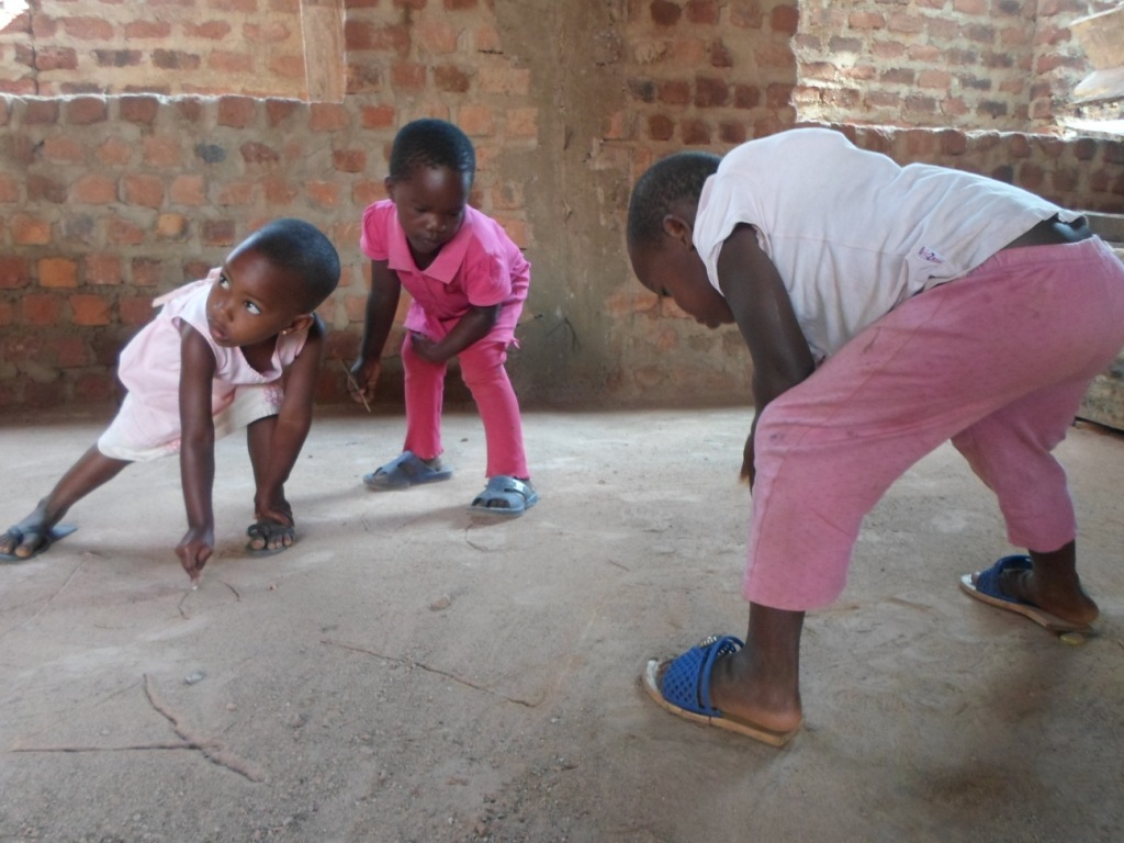 Children learn to write on the ground.