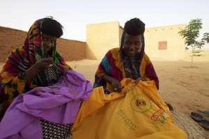 Naiwa & Bappa embroidering Wodaabe symbols.