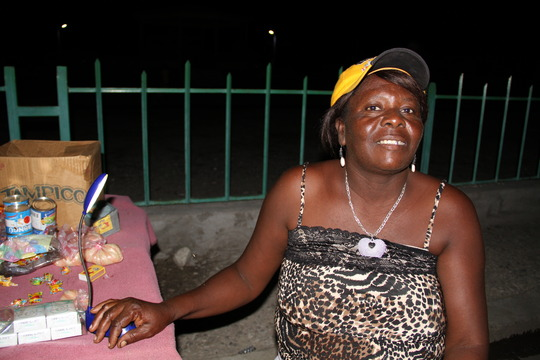 A  vendor lights her stall at night with solar