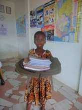 Receiving her first learning materials from TANF