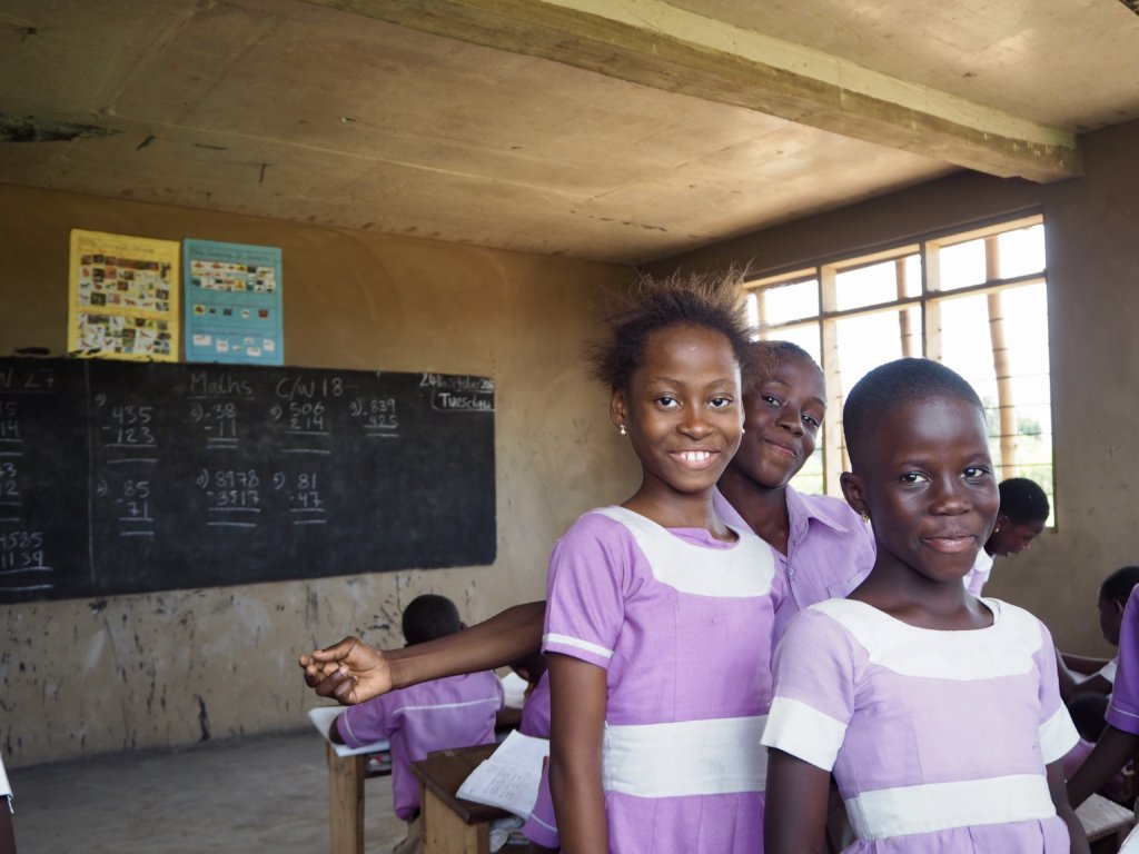 Benedicta happy in class with her class mates