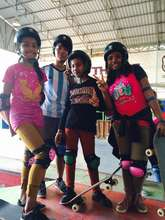 The girls in their gear, ready to skateboard