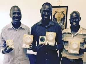 Receiving solar lights in South Sudan
