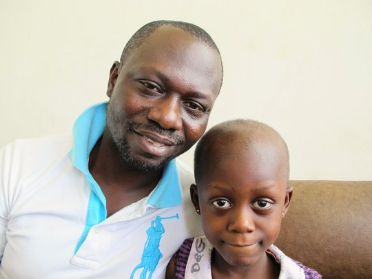 Five-year-old Faustina with her father Eric