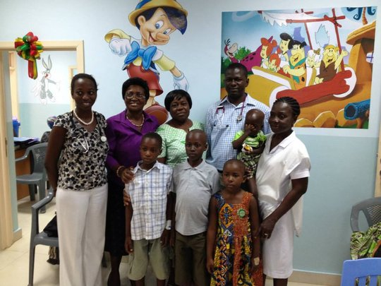 Project Lead Dr. Renner with patients & staff