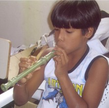Youngster Practicing His Music