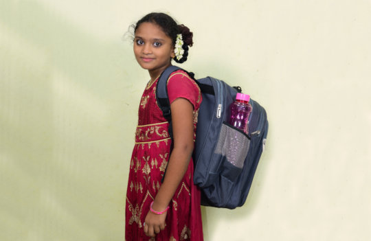 Posamma with her new backpack and supplies
