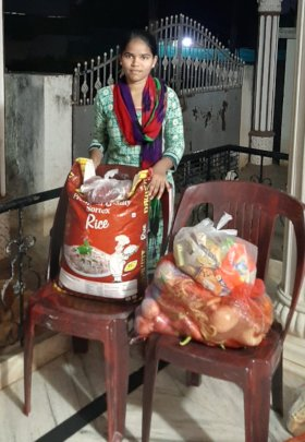 Sudharani with a food relief packet