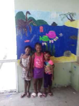 Children from Spring Village standing in front of