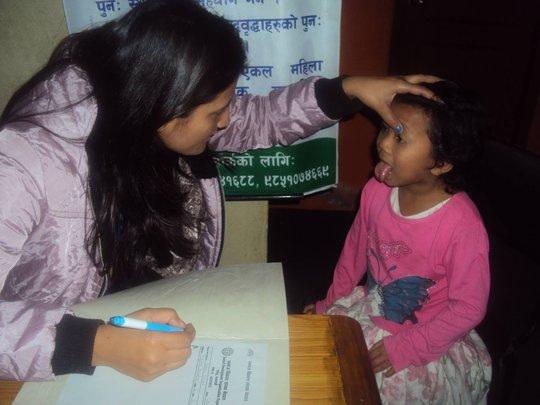 Dr.Seesam on regular health checkup of children.