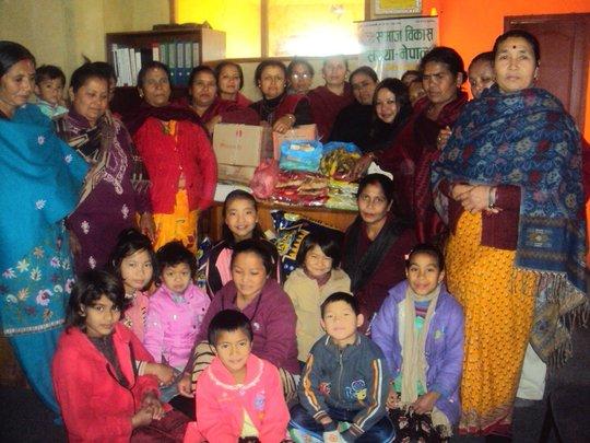 Children happy with CHETANSIL Women Group members.
