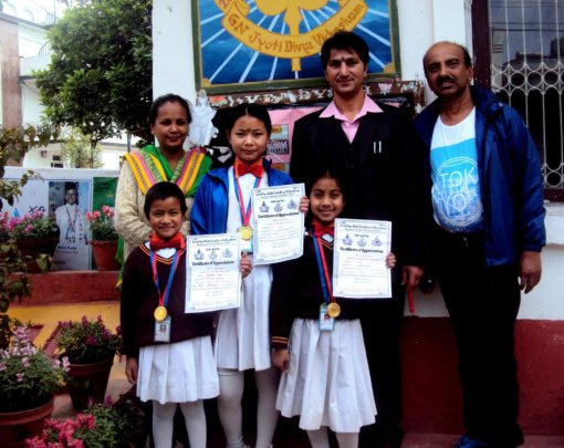 GIRLS awarded with MEDALS from School's Principal.