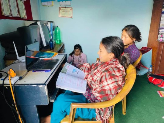 Children attending online classes at child home.