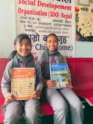 Pratiksya and Rosani of class-4 ready to school.