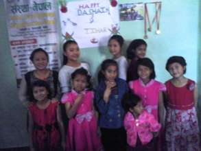 Children happy with their new dresses.